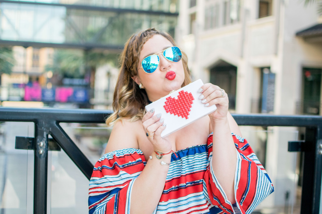 Red, white and blue outfit with darkn wash denim and red lips